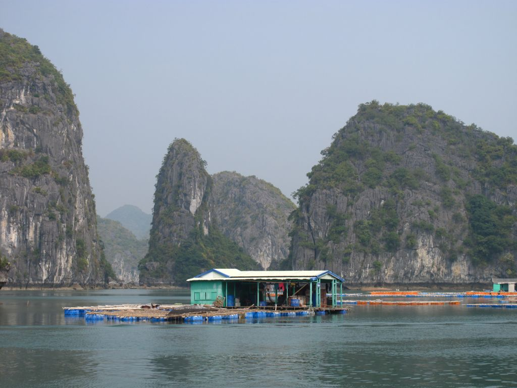 Floating fish farm house in Halong bay